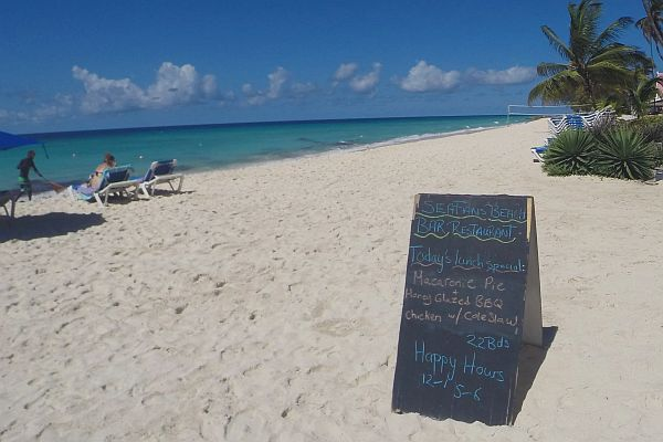 Happy Hours sign on the beach